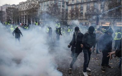 BATTLEFIELD PARIS Police bombarded with fireworks fight back with tear gas as mass riots turn Paris